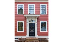 Red House on High Street / A quaint 19th century home gets a makeover with bright bedrooms, a new kitchen, and beautiful curved second floor staircase. Red clapboards and black sashes revived the dull exterior.