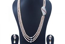 Magnificent 3 Lines Long Pearl Necklace with Side Pendant and bright pink pearls at Rs. 11,400