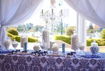 Navy Damask Lolly Bar / This bold and elegant patterned Lolly Bar was framed by the beautiful Brisbane River. Set along the Dockside, this colour palette complimented the setting perfectly. Custom wrapped chocolate bars, small parcels packaged in Navy Satin ribbon, all adorned with a Glass Chandelier to illuminate the delicious treats on display.  See our stunning film showcase at www.youtube.com/watch?v=nI-w-LSCCdk  Enchanted Empire