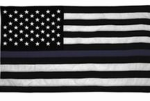 Thin Blue Line Merchandise / The Meaning of the Thin Blue Line Flag: The Blue represents the officer and the courage they find deep inside when faced with unbelievable odds. The Black background was designed as a constant reminder of our fallen brother and sister officers. The Flag symbolizes the relationship of law enforcement in the community as the protectors of civilians from criminal elements. It is symbol representing the camaraderie of Police Officers.