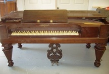 Square Grand Pianos / aka Box Grands or Victorian Square Pianos. An early form of pianoforte w/rectangular cabinet, 4 legs and strings running left to right. During the 18th-19th centuries, Square Grand Pianos were extremely popular in the US and Europe. By 1865, compact uprights (aka 'cottage' or 'piccolo' pianos) had arrived. Today's Grand Pianos are patterned after the harpsichord but the Square Grand Piano was patterned after the clavichord and thus had a different sound.