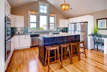 Gourmet Kitchens / From double stainless refrigerators to slick granite counters and viking ranges - prepare meals with style and luxury in our Premier Home gourmet kitchens.