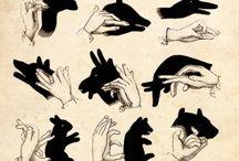sombras na parede com as  mãos