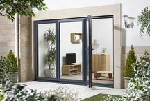 NEW EXTERNAL ALUMINIUM FOLDING SLIDING DOOR SETS / New to Emerald Doors, available in 3 widths across 2 finishes either Prefinished White or Prefinished Grey, these sets benefit from being Part L complaint and also Part M complaint meeting current building specifications. 70mm thick with thermally efficient, argon filled, toughened Low 'E' double glazed unit giving a whole product U value of 1.6W/m2K. Weather tested to BS 6375 Part-1:2009 (with aluminium cill)