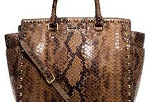 Handbags...oh my! / by Kathy Flores-Ramirez