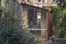 Rug Room / Webb Yates Engineers were responsible for the design of a cor-ten steel-clad plywood structure for a private studio located in Oval, London. The client wanted a simple and elegant place to read and work. The studio is located at the end of a narrow garden facing both the rear of an early Victorian crescent and a secret garden. Architect: Nic Howett - Photography: Damian Griffiths