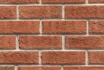 Full Color Antique   Triangle Brick Company / If you're searching for a classically-styled architectural brick in a not-so-traditional hue, try Triangle Brick Company's Full Color Antique brick, offered under our Standard tier. A rich orange base, subtle brown accents, and textured finish make this brick one of our most distinctive contemporary products. Interested in a similar look in a lighter shade? You may also like our Light Antique brick.