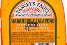 House of Heat / Welcome to Hot Stuff's House of Heat, where we highlight our spicy cheeses. We've rated them on a scale from 1 - 10 with 10 being the hottest, so if you're into cheeses with a little (or a lot) of kick you need to check out our spicy line of Yancey's Fancy Cheddar!