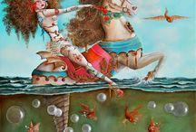 """Exhibition """"ANA HERNANDEZ"""" / """"O imaginário surreal pop está presente nos trabalhos da artista espanhola Ana Hernández. A inspiração surge do universo feminino e o resultado revela-se em uma exaltação ao meditativo, evoca mistério e fantasia. A personagem com penteados extravagantes e roupas pouco usuais, interage com animais, brinquedos, máscaras e outros elementos, juntos criam um mundo inocente e ao mesmo tempo perturbador""""."""