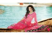 Designer Sarees / Developer sarees create a lady look stunning, younger and chic! Most designer use such as net sarees and georgette sarees are done up with shiny shades and strong yet elegant styles on them.