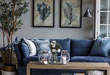 Decorar salón con sofá azul