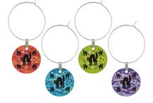Halloween Themed Wine Related Products at Three Cats Graphics' Zazzle Shop / A selection of Halloween themed wine charms, wine stoppers, wine bags, and other wine related items from Three Cats Graphics Zazzle Shop. Most products are customizable.
