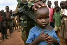 Soldiers children. / Soldiers children fighting in a war in Uganda
