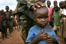 Soldiers children. / Soldiers children fighting in a war in Uganda