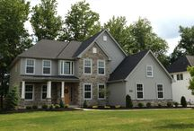 "The Nora Marie - Avon Lake Sales Center / Just completed and ready for immediate occupancy, the ""Nora Marie"" is a wonderful, open floor plan! The first floor features a three-sided fireplace between the two-story family room, hearth room and kitchen. Granite countertops with custom-tiled backsplash highlight the kitchen, which is connected to the formal dining room via butler's pantry. The two-story open foyer is flanked by the dining room and private study. Laundry and mud rooms complete the first floor, with built-in bench."