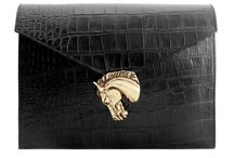 W&G Leather / The 'Stanley' is a leather cross-body shoulder bag finished with a gold plated brass animal. Perfect for the day or casual night!  This bag is still available online.  The 'Ruby' is our leather oversized envelope clutch made from classic crocodile print embossed leather. It can hold a 13 inch laptop and A4/US size legal documents. It's a must have for every busy woman!