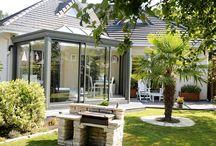 Veranda contemporaine à toiture plate en Normandie