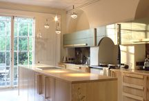 Arts and Crafts inspired kitchen and living room / hand carved solid maple kitchen and designer lighting