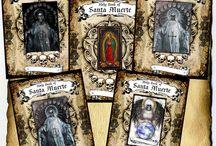 Santa Muerte: Cauldron Craft Oddities / I create a variety of religious items dedicated to La Madrina, Santa Muerte. / by Grim