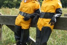 girls in chest waders in mud