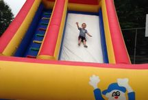 Slides / We offer dry inflatable slides as well as water slides! View our board for options and where to find more details.
