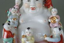 """Buddha Laughing Ho Tai / Ho Tai, as he is called in Chinese, is often confused with the Historical Buddha.(...)is not the Buddha at all, but is actually a revered Chinese Monk.http://www.thebuddhagarden.com/buddha-poses.html   Budai or Pu-Tai is a Chinese folkloric deity. His name means """"Cloth Sack"""",and comes from the bag that he is conventionally depicted as carrying. Budai, https://en.wikipedia.org/w/index.php?title=Budai&oldid=761711692 (last visited Feb. 11, 2017"""