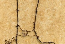 Barbed Wire Art/Horseshoe Art / by Cheryl Favre