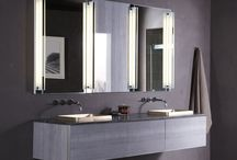 Vanities / Innovative aluminum and glass construction allows even hot styling tools to be safely stored. These vanities can be mounted or stacked to create customized storage solutions. Both slow-close and push-to-open configurations are available, and optional features include a night light, hair styling organizer, electrical outlets, a slim drawer insert and a toilet paper holder.