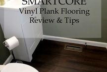 SMARTCORE flooring / Smartcore Vinyl Plank Flooring by Natural Floors  100% waterproof and can be installed in wet areas, planks will never swell when exposed to water Can be installed directly over other existing hard surface floors Easy-to-install, drop and lock profile without glue and with no acclimation time needed Dimensionally stable; will not expand or contract Limited lifetime-residential and 5-year light-commercial warranty