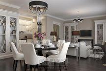 Кухня-гостиная в стиле арт-деко / Гостиная в стиле арт-деко делит единое пространство со светлой столовой и кухней в углублении комнаты. Принцип студийности в данном случае способствует более рациональному использованию имеющихся площадей. Декорированные зеркальной плиткой колонны помогают провести условные границы в интерьере. Благодаря им, диванная зона приобретает более четкие очертания, а кухня получает дополнительную «перегородку». Зонированию способствует и консоль, разместившаяся за спинкой дивана.