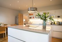 A Sense of Space / Our client had completely renovated a small terraced Edwardian cottage and the last big challenge was the kitchen. She had knocked the tiny old kitchen and dining room into one large space and now she wanted a simple layout with an island and an understated look overall. There were to be no wall units to keep the room feeling spacious and the plan was to place a circular dining table in the corner of the room to balance the rectangular shapes of the units.