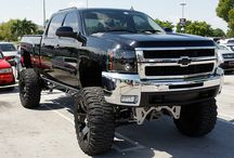 lifted trucks / by Allie Barton