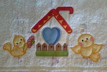Applique / Applique is an ornamental needlework in which pieces of fabric are sewn or stuck on to a larger piece to form a picture or pattern.