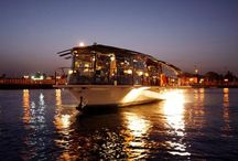 Bateaux Dubai / Experience dining with elegance with Bateux Dubai dinner cruise, named as one of the best floating restaurant in Dubai they serve an international cuisine to cater to the taste buds and dietary needs of all. With its glass enclosed vessel, live entertainment provided by fine Mexican singers that will serenade you with their sweet music, their personalized service ,romantic ambience and the panoramic view of Dubai Creek makes your cruise is as inspiring as the city itself.
