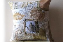 Cushions with doilies and teatowles