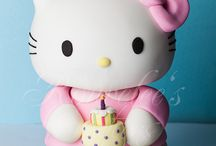 Hello kitty cakes and figures.