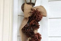 door hanging with pine cones
