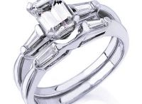 Emerald Cut Diamond Rings / The elongated shape of an emerald cut diamond from King of Jewelry, particularly when paired with accent stones like tapered baguettes and other emerald cuts.