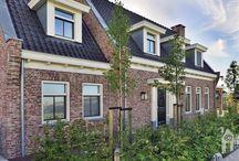 WnS Architecten, notariswoning / Een gedetailleerde woning met karakter,  met een  eiken veranda die nét iets buiten de woning komt maar ook bij de integratie van de uitbouw naast de keuken.