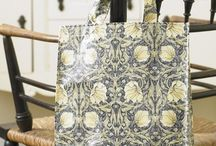 William Morris Bags / Our range of William Morris bags are specially made for us in the UK by the company who make the bags for that most famous London department store.  There are three sizes small, medium and long handle.  All have the pvc wipe clean coating.