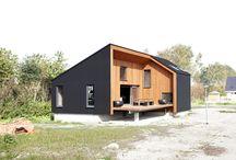 houtenhuis met zwart rubberen rand