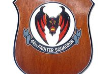Custom Wooden Award Plaques / Our custom wooden squadron shield plaques are made from solid wood mahogany. These are hand-carved and painted, great for military collection, award ceremonies or recognition events! We can make custom shield plaques in any squadron logo and texts. The price includes one logo and two-lines of carved text!