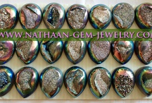 Natural Window Druzy Agate Cabochan Drusy Gemstones- Titanium Coated Colors with Shiny Grains 65 to 90% Crystals Grains Available from Nathaan-gem-jewelry / In geological usage druse or druzy is a coating of fine crystals on a rock fracture surface, vein or within a vug or geode.  Natural Window Druzy Agate Cabochan occurs worldwide, the most common is perhaps quartz druse within voids in chert or agates. Calcite, dolomite and a variety of minerals may occur as druse coatings.  Drusy quartz crystals are excellent for use in Spiritual Healing when self-doubt, worry, or other negative feelings are affecting the ability to feel the joy of life.