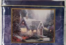 "ZoeAnne's Etc. Puzzles! / Jigsaw puzzles are great for a rainy afternoons or quite times on a lazy summer evening. They are the perfect opportunity for engaging hours of fun to your family and friends! Puzzles also make excellent gifts for just about anyone!  About Thomas Kinkade Thomas Kinkade is known for his tranquil, paintings with infused light, ""The Painter of Light"". Each painting has a peaceful message that represents home, family and faith. The goal of Thomas was to touch all faiths with hope and joy."