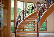 Tropical Stairs / Arcways TROPICAL stairways follow a broad spectrum of historical faithful influences. Our freestanding and wall supported stairways can be completely customized with custom shaped (not bent) handrail profiles; helical descending volutes with barrel bases; carved skirt brackets; stone treads & risers; hand carved balusters from Spain; hammer forged custom iron railings and more.
