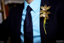 "Tiarè  Floral Design boutonnière / A boutonnière (French: [butɔnjɛʁ]) is a floral decoration worn by men, typically a single flower or bud. Boutonnière is the French word for ""buttonhole""."