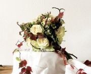 BOUQUET OF AUTUMN: white roses, hydrangeas and raspberries between elements of nature