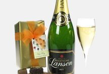 Champagne And Chocolates / Certain things are made for each other and i'am not talking about me and the wife! A little luxury goes a long way so when you put together a chilled bottle of Champagne and some luxurious Belgian chocolates you simply can't loose.