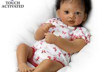 Wantraud Hanl - bruin babymeisje met krulletjes
