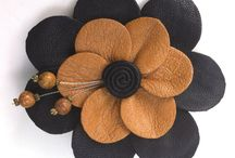 Fine Leather Brooches and Barrettes / This board highlights some of Blue Pear Emporium artisan Elizabeth Gregory's fine leather brooches and barrettes.  A talented and meticulous crafter, she is know for her fine craftsmanship. Love her creations!